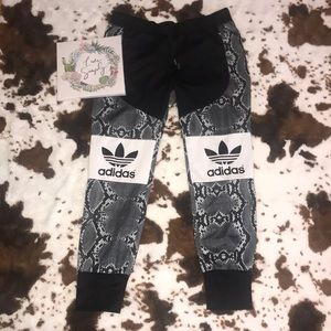 Adidas Limited addition snake skin joggers | L